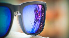 Bubbles Reflected on Lens of Black Framed Sunglasses Stock Images