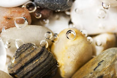 Bubbles on  rocks Royalty Free Stock Photography