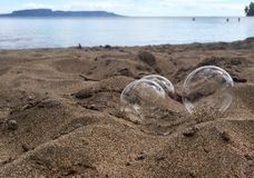 Bubbles on the sand stock photo