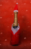 bubbles santa champagne red dressed bootle Royalty Free Stock Photography