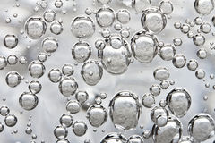 Bubbles of sparkling water Stock Image