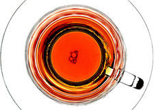 Bubbles In A Teacup. Bubbles floating  in tea that is in a cup on a saucer Stock Images