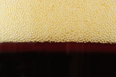 Bubbles on Top of Fizzy Soft Drink Stock Images