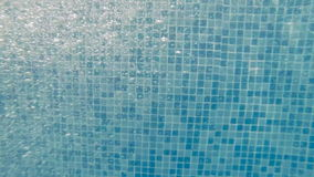 Bubbles under water. Water in the pool. stock video footage