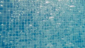 Bubbles under water. Water in the pool. stock footage