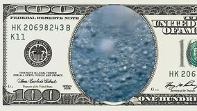 Bubbles underwater in frame of 100 dollar bill. Bubbles underwater background in frame of 100 dollar bill. Money gain or lose concept stock footage