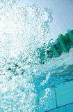 Bubbles in water of the swimming pool. Rising bubbles in water of the swimming pool Stock Image