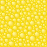 Bubbles on yellow background. Stock Photo