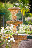 Bubbling fountain in courtyard garden Royalty Free Stock Photo