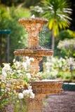 Bubbling fountain in courtyard garden Royalty Free Stock Photo