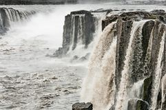 Selfoss Waterfall. The bubbling, muddy waters of the Selfoss waterfall under gray, rainy skies, Iceland Stock Images