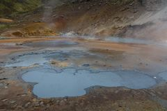 Bubbling mud pots and steam vents in Seltun, Iceland stock photo