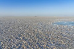 Bubbling pond in the salt plains of Asale Lake in the Danakil Depression in Ethiopia, Africa. Bubbling pond in the salt plains of Asale Lake in the Danakil stock photography