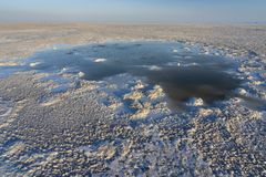 Bubbling pond in the salt plains of Asale Lake in the Danakil Depression in Ethiopia, Africa. Bubbling pond in the salt plains of Asale Lake in the Danakil royalty free stock photos