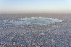 Bubbling pond in the salt plains of Asale Lake in the Danakil Depression in Ethiopia, Africa. Bubbling pond in the salt plains of Asale Lake in the Danakil stock image