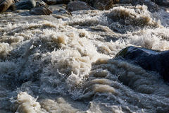 Bubbling stream. Of water in a mountain river Royalty Free Stock Photos