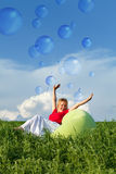 Bubbling vitality - woman on spring grassland stock photos