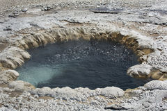 Bubbling water in circular hot spring, Yellowstone National Park, Wyoming. Stock Photography