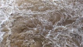 Bubbling water in a river stock footage