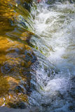 Bubbling Water. Water streams over rocks along a small creek Stock Photography