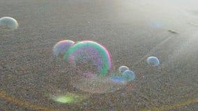 Bubblor på stranden Arkivbild
