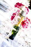 Bubbly and candles among crystal Royalty Free Stock Image
