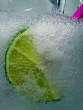 Bubbly Cool Drink. Lime in a cool foamy beverage royalty free stock photo