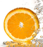 Bubbly Orange Slice. A macro shot of a slice of orange under water with bubbles rising Royalty Free Stock Photos