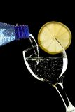 Bubbly water being poured into a glass royalty free stock photography