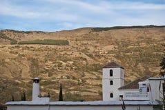 Bubión Church and fireplace in the Alpujarra. View of the tower of the Church of Bubión, Alpujarra Stock Photos