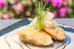 Bubu Arare Crusted Salmon. Two salmon steaks crusted with bubu arare served in sauce Royalty Free Stock Photos