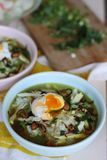 Bubur ayam chicken congee. Bubur ayam Indonesian for `chicken congee` is an Indonesian chicken congee. It is rice congee with shredded chicken meat served with Stock Photo
