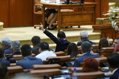 The lider of a parliamentary group signals to his coleagues. BUCAREST, ROMANIA - JULY 4, 2018: The lider of a parliamentary group signals to his coleagues how to stock images