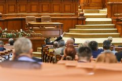 The lider of a parliamentary group signals to his coleagues. BUCAREST, ROMANIA - JULY 4, 2018: The lider of a parliamentary group signals to his coleagues how to stock photos