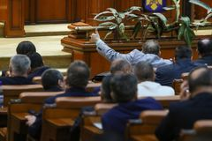 The lider of a parliamentary group signals to his coleagues. BUCAREST, ROMANIA - JULY 4, 2018: The lider of a parliamentary group signals to his coleagues how to stock image