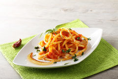Bucatini Amatriciana, with parmesan cheese, tomato and bacon. On complex background Royalty Free Stock Photos