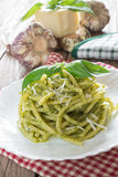 Bucatini pasta by pesto Royalty Free Stock Photo