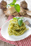 Bucatini pasta by pesto Stock Photo