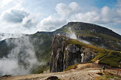 Bucegi Landscape. A landscape from Bucegi Plateau with clouds near land stock images