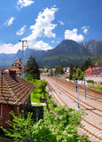 Bucegi mountain view and train station in Busteni, Romania Royalty Free Stock Photos