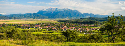 Bucegi mountain and village in Transylvania Royalty Free Stock Photography