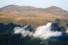 Bucegi mountains. View in the Bucegi mountains with clouds in front Stock Images