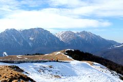 Bucegi Mountains. Snowy peaks of the Bucegi Mountains, viewed from Sorica mountain top in Azuga - Bucegi Mountains are located in central Romania, south of the royalty free stock photos