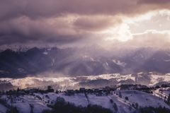 Bucegi Mountains. A break in the storm with blizzard blowing the fresh snow Stock Photos