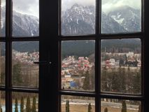 Bucegi mountains. And BuÈ™teni city view from windou of Cantacuzino castle stock image