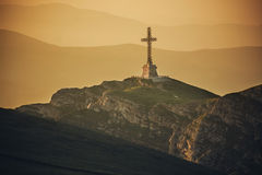 Bucegi Mountains, the Caraiman cross. Bucegi mountains, Romania. View of the Caraiman cross Royalty Free Stock Photo