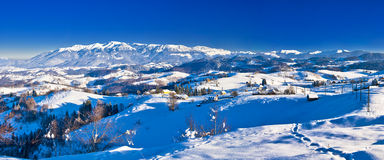 Bucegi mountains landscape panorama in Romania. Winter rural landscape in Romania, Sirnea village, Carpathian mountains (Bucegi royalty free stock photos