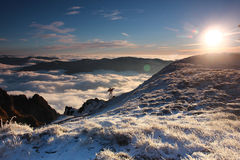 Bucegi Mountains. Over clouds winter view from Bucegi Mountains in the morning after sunrise stock photography