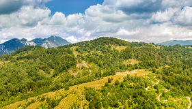Bucegi mountains panorama. With a small church and Postavaru peak in the background, viewed from Paraul Rece resort stock photos