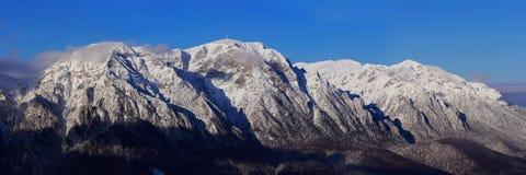 Bucegi mountains panorama in winter - Romania. Bucegi mountains and Caraiman cross top in winter,Romania Stock Photos